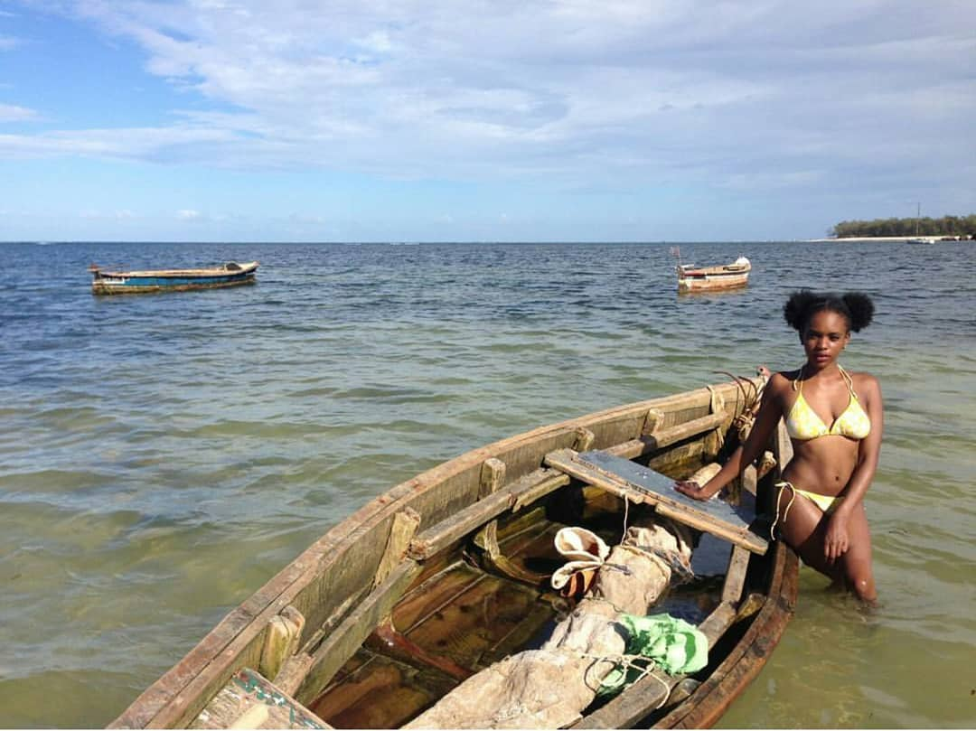 rocking a bikini while in malindi kenya pose with a dhow