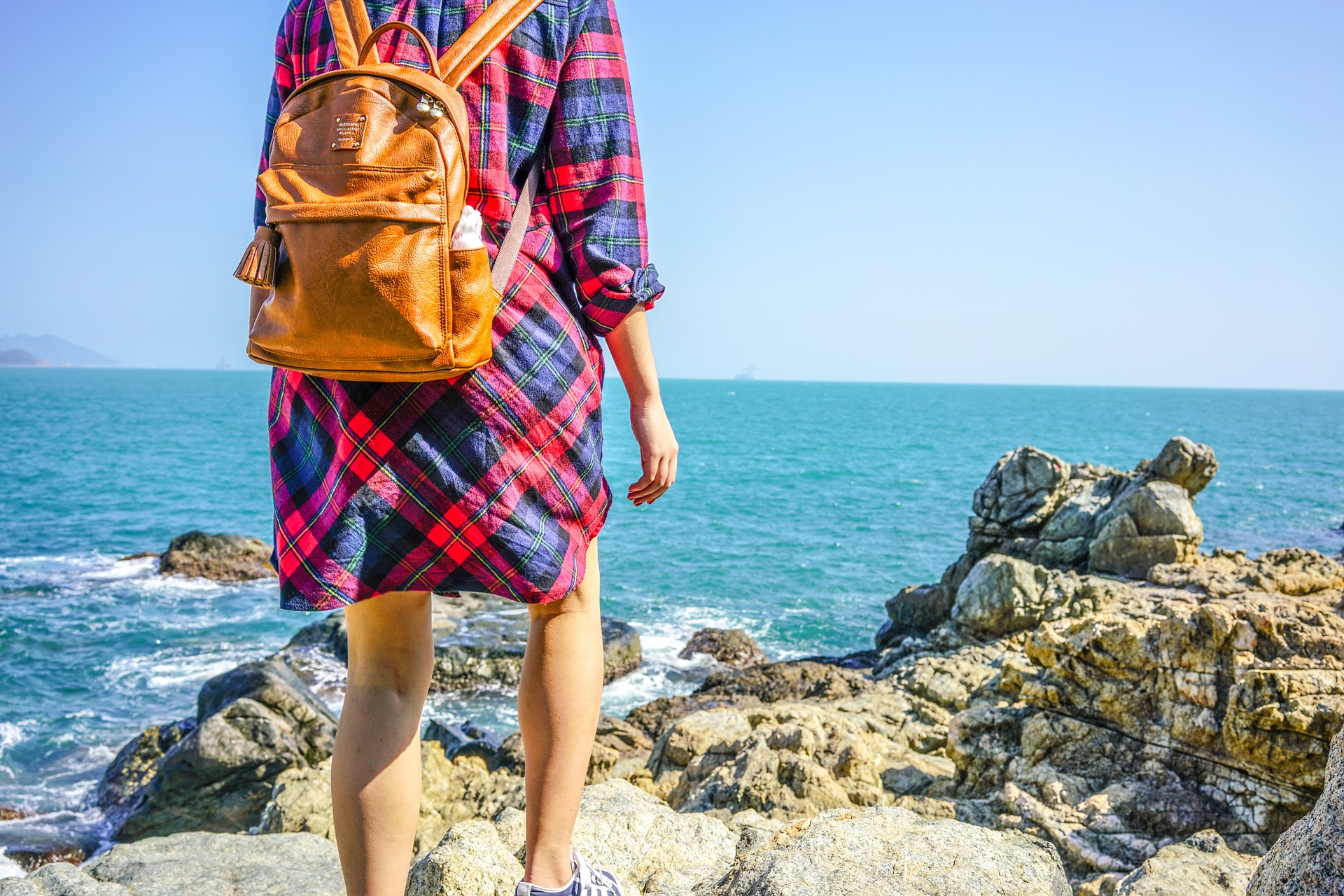 a girl on a backpack at the beach
